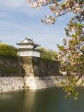Osaka defending Turret. Military white turret of Osaka Castle with cherry tree view Royalty Free Stock Images