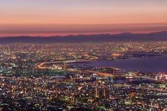 Osaka en Kobe in de schemering, Mening van Kukuseidai van MT maya royalty-vrije stock afbeelding