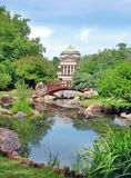 Osaka Garden in Chicago. Japanese bridge, Osaka Garden located in Jackson Park, Chicago. Museum of Science and Industry is in the background stock photography