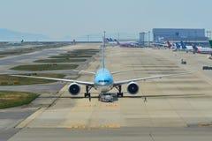 Passenger airplanes taxiing on runway. Osaka, Japan - Apr 19, 2019. HL8250 Korean Air Lines Boeing 777-300ER taxiing on runway of Kansai Airport KIX. The airport stock photos