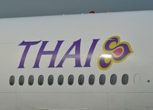 Thai Airways logo on aircraft body stock images