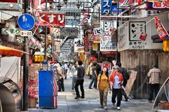 Osaka, Japan. APRIL 25, 2012: People visit Shinsekai district in . Osaka is the 3rd largest city in Japan (2.8 million people) with population of metro area Stock Photos