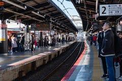 OSAKA, JAPAN - JAN 31, 2018: Locals and tourists waiting train in station of Osaka stock photography