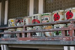 OSAKA, JAPAN - JAN 31, 2018: Old traditional sake and rice barrels in temple of Osaka royalty free stock photo