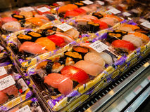 OSAKA, JAPAN - JULY 18, 2017: Seafood, sushi rolls inside of a plastic box in a market in Kuromon Ichiba market on in. Osaka, Japan. it is market places popular Royalty Free Stock Image
