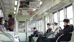 Osaka, Japan -Local Japanese people riding the train out to Kyoto in the morning stock footage