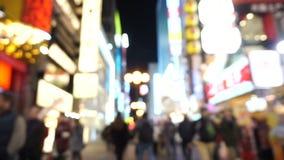 Osaka, Japan- March 2015 -Dotonbori shopping street and landmark at night blurry stock video footage