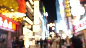 Osaka, Japan- March 2015 -Dotonbori shopping street and landmark at night blurry stock video