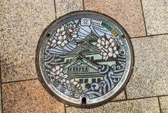 OSAKA, JAPAN - NOV 21, 2016: Decorative manhole cover in Osaka. Royalty Free Stock Photos