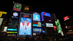 OSAKA, JAPAN - NOVEMBER 24: The Glico Man billboard and other li Royalty Free Stock Photography