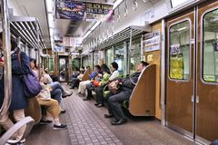OSAKA, JAPAN - NOVEMBER 22, 2016: People ride a subway train in Osaka Metro, Japan. Osaka Metro has 133 stations and carries more. Than 2 million passengers stock photography