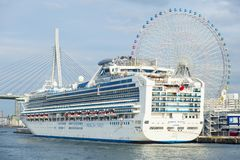 Osaka japan - november8,2018 : princes cruises luxuri cruising ship approach on port of tempozan osaka royalty free stock image