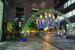 Osaka, Japan. Temple in Osaka in spring, blooming season, cherry blossoms.Decoration of star festival, called `Tanabata`, in Umeda. OSAKA, JAPAN. Decoration of royalty free stock photography