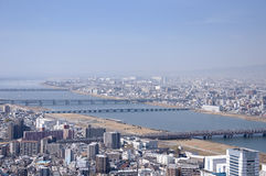 Osaka Japan and Yodo River. The Yodo river splitting two halves of Osaka Japan as seen in an aerial view Stock Images