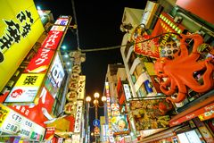 Osaka Kani Doraku crab. Osaka, Japan - April 29, 2017: bottom view of bright neon signboard at night and mechanic Kani Doraku crab sign of popular Japanese Stock Images