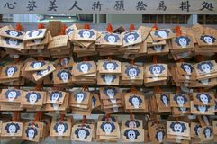 Wooden Ema`s votive plaques hanging at Tsuyunoten Shrine in Osaka royalty free stock image