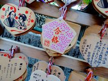 Wooden votive plaque Ema`s hanging at Tsuyunoten Shrine stock image