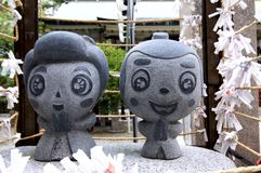 Close up picture of the small Ohatsu and Tokube stone statue at the Tsuyunoten Shrine in Osaka stock photos