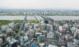 Osaka metropolis cityscape view. Osaka metropolis cityscape. Viewed 170 meters aboveground from Umeda Sky Building in Shin Umeda City, Floating Garden Royalty Free Stock Images