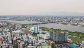 Osaka metropolis cityscape view. Osaka metropolis cityscape. Viewed 170 meters aboveground from Umeda Sky Building in Shin Umeda City, Floating Garden Royalty Free Stock Photos