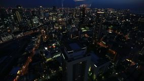 Osaka skyline twilight. Aerial view of Osaka City Central Business downtown at twilight. Osaka Skyline from Floating Garden Observatory Umeda Sky Building in stock video footage