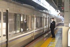 Osaka Station. OSAKA ,JAPAN - DEC 7 : Train approaching Osaka Station on December 7,2015 in Osaka,Japan. this is a major railway station in Osaka, Japan Royalty Free Stock Photo