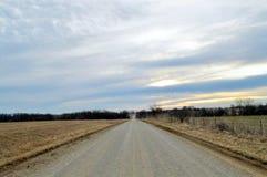 Osamotniona droga z Malującym Sinrise niebem Fotografia Royalty Free