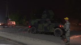OSAN AIR BASE NORTH KOREA, NOVEMBER 2015, Military Training HMVEE Armed Vehicle Drive Street. HMVEE armed military vehicles with machine gun on the top at a stock footage