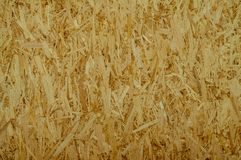 OSB – oriented strand board. Oriented strand board texture, OSB plate, wood chips Royalty Free Stock Photos