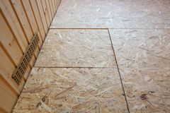 OSB boards flakeboards laid on floor Royalty Free Stock Images