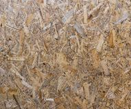 OSB boards are made of brown wood chips royalty free stock photo