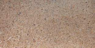 OSB boards are made of brown wood chips sanded into a wooden background. Top view of OSB wood veneer background, tight, seamless s. Urfaces Royalty Free Stock Photos