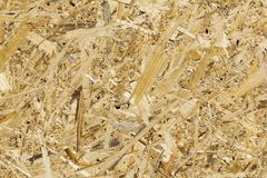 OSB boards are made of brown wood chips royalty free stock photography
