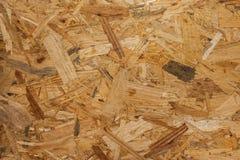 OSB - El fondo de madera presionado del panel, textura inconsútil de orien Imagenes de archivo