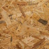 OSB - El fondo de madera presionado del panel, textura inconsútil de orien Foto de archivo