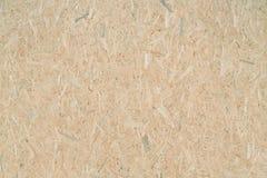 OSB - orienterat trådbräde eller QSB - kvalitets- trådbräde, träflismaterialtextur eller träflismaterialbakgrundsbild royaltyfri fotografi