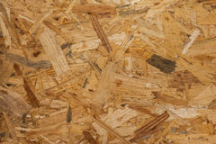 OSB - Pressed wooden panel background, seamless texture of orien Stock Images