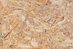 OSB tekstura materiał - przetwarzający ściśnięty drewnianych układów scalonych talerz, sklejkowa tekstura, w górę obrazy stock