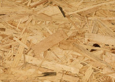 Osb wood background, small pieces flat lay Royalty Free Stock Photography