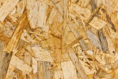 OSB wooden background Oriented strand board used in the construction industry.  stock photo