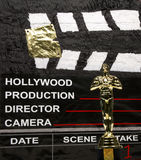 Oscar Award. Movie scene marker and miniature Oscar statuette Stock Images