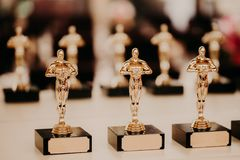 Oscar award. Prize for victory. Golden trophy,. Success concept. Horizontal shot. Prize in film production stock image