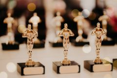Oscar award. Prize for victory. Golden trophy,. Success concept. Horizontal shot. Prize in film production. Bowl award before the presentation on the table royalty free stock photography