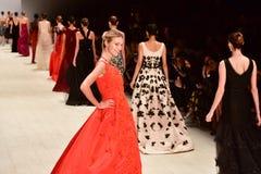 Oscar de la Renta fashion show. SYDNEY / AUSTRALIA - 20 May: Model walks on runway during Oscar de la Renta collection fashion show at Mercedes Benz Fashion Week Royalty Free Stock Photography