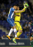 Oscar Duarte of Espanyol and Antonio Adan of Real Betis. Oscar Duarte(L) of Espanyol and Antonio Adan(R) of Real Betis fighting during a Spanish League match at stock photos