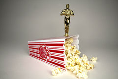Oscar Night. Oscar figuring with bag of popcorn kernels Royalty Free Stock Photo