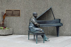 Oscar Peterson Statue, Ottawa. Oscar Peterson was a Canadian jazz pianist and composer. In June 2010 a life size bronze statue of Oscar Peterson at the National stock images