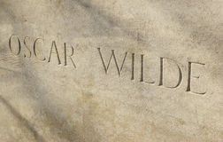 Oscar Wilde. The name Oscar Wilde sculpted in stone on his tomb. Père Lachaise, Paris, France Royalty Free Stock Photo