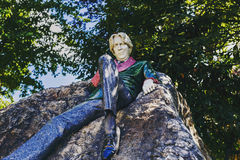 Oscar Wilde`s statue in Merrion Square Park in Dublin city centr. DUBLIN, IRELAND - 10th June, 2017: Oscar Wilde`s statue in Merrion Square Park in Dublin city royalty free stock photo