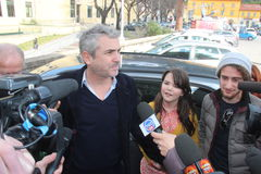 The oscar-winning alfonso Cuarón with dauther Bu. The oscar-winning director Alfonso Cuarón, celebrated by the Mayor and the City Council of the royalty free stock images